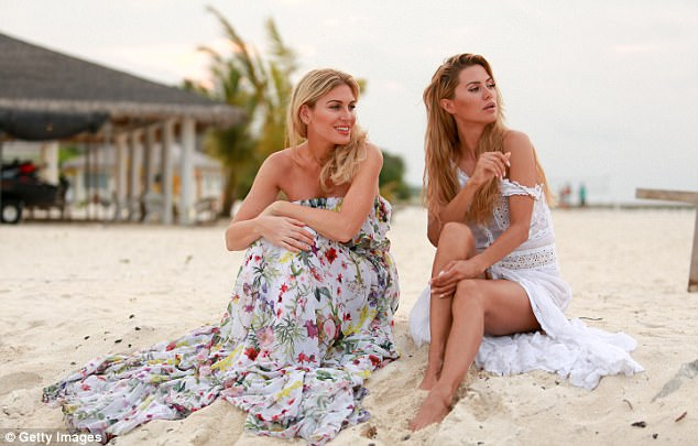 A moment of peace: Hofit and her pal, model and TV host Victoria Bonya, covered up for a brief stint as they slipped into billowing maxi dresses while gazing into the distance